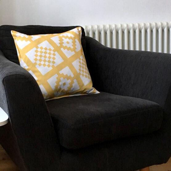 mustard geo-print cushion