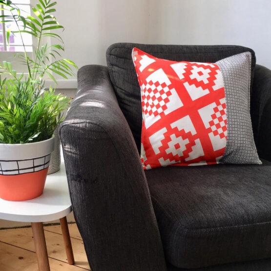 tangerine and charcoal geo print cushion