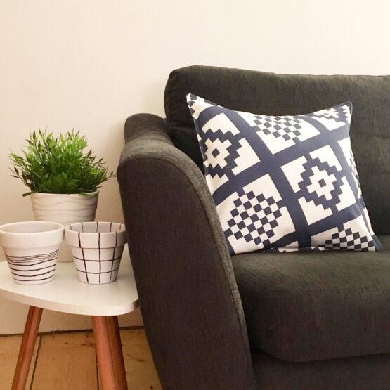 navy geo-print cushion