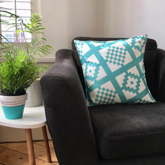 teal geo-print cushion